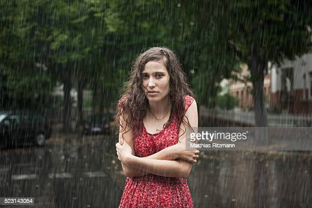 Woman in downpour