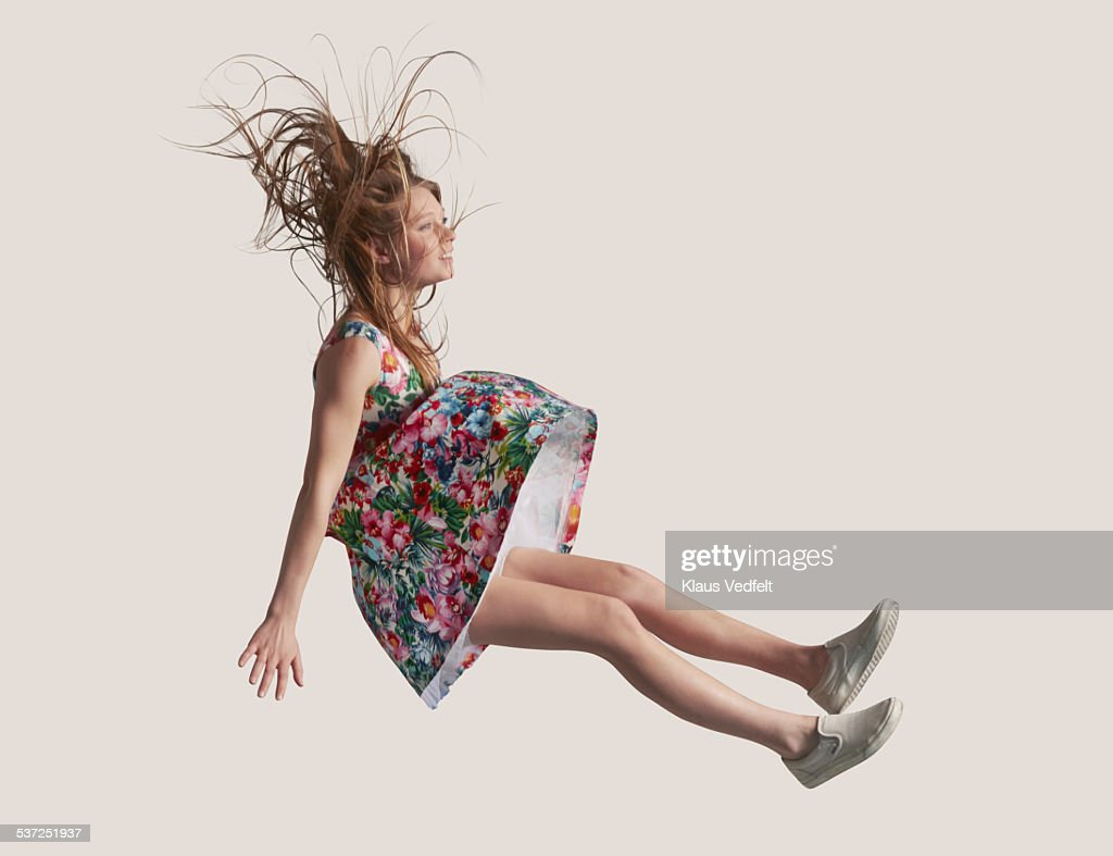 Woman in dress in the air, falling down