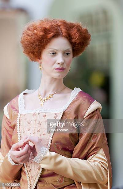 A woman in Elizabethan-style period costume