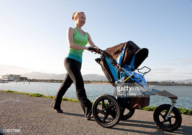 Woman in exercise clothes with baby jogger.