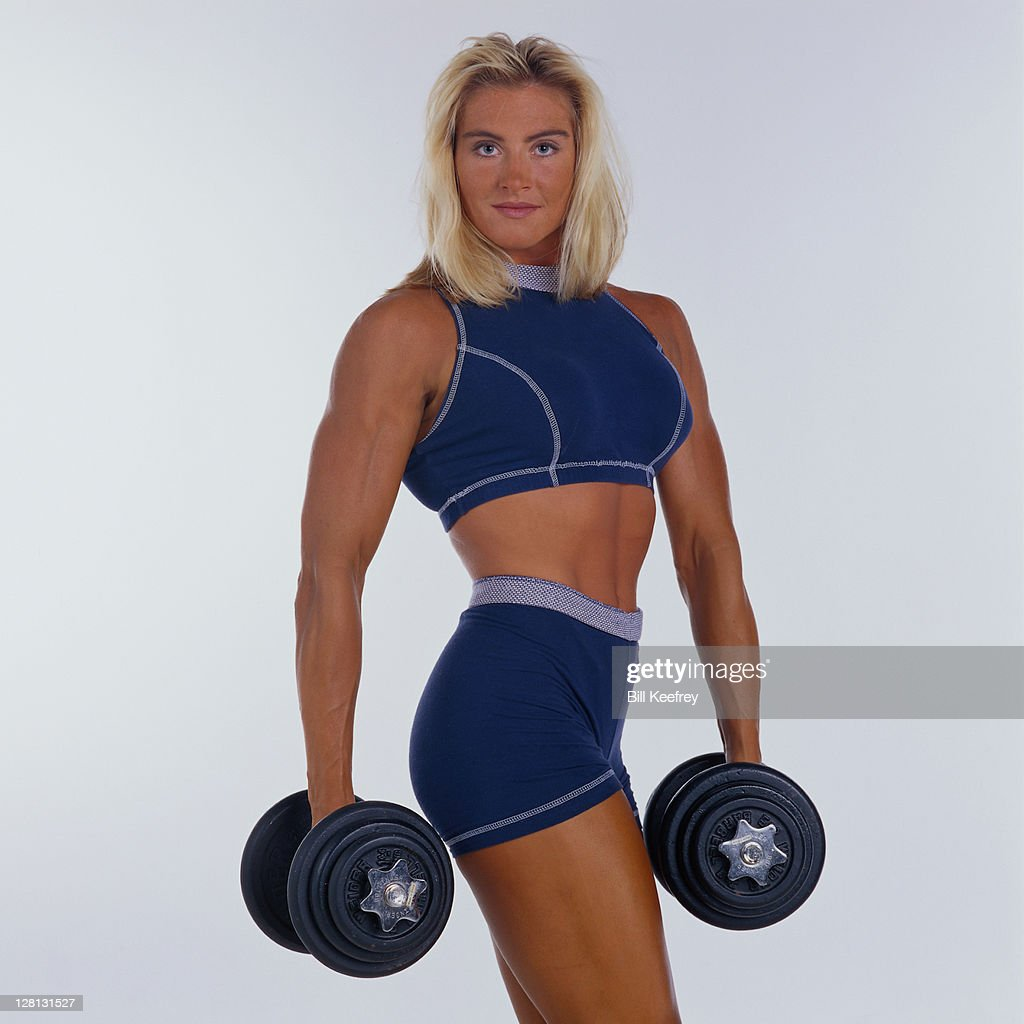 PERBE003 Woman in exercise outfit holding dumbbell : Stock Photo