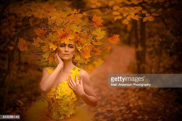 Woman in fall fashion modeling in a Fall scene