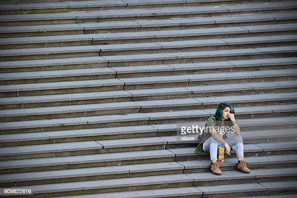 Woman in famous stairs on city square Sergels Torg, Stockholm