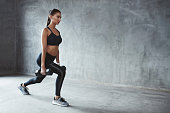Woman In Fashion Sports Clothes Training, Doing Lunges Exercise With Dumbbells. High Resolution