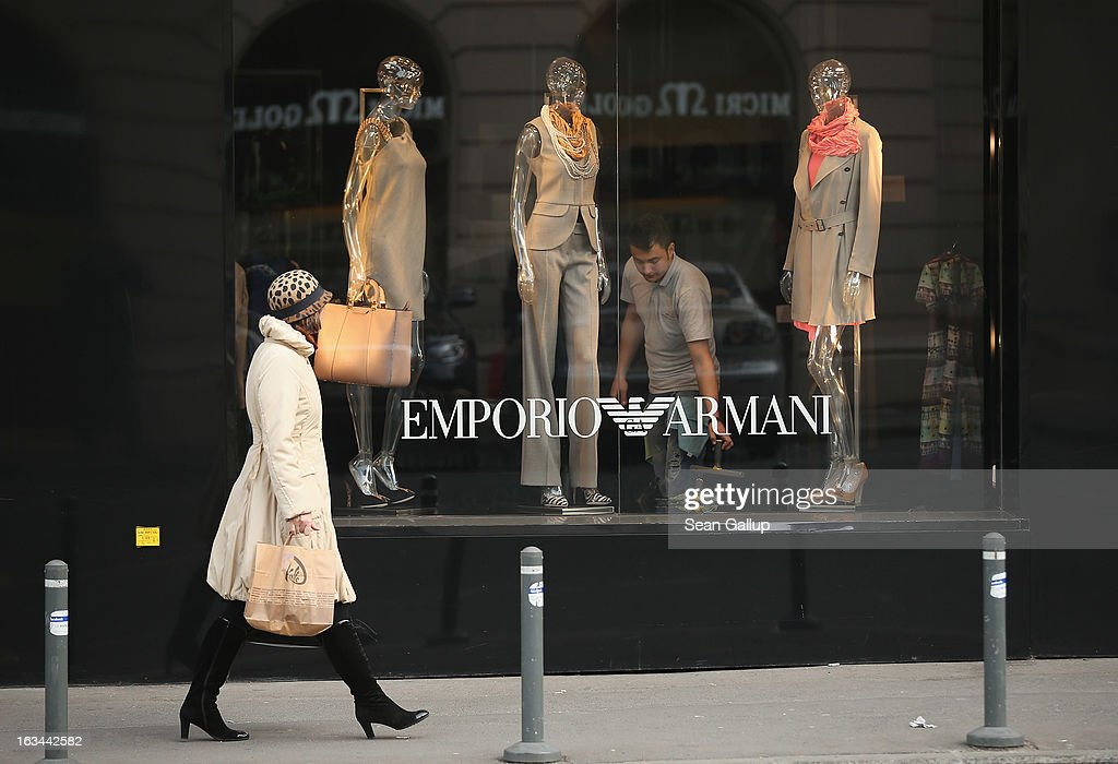A woman in fashionable clothing walks past an Armani luxury store on March 8, 2013 in Bucharest, Romania. Both Romania and Bulgaria have been members of the European Union since 2007 and restrictions on their citizens' right to work within the EU are scheduled to end by the conclusion of this year. However, Germany's interior minister announced recently that he would veto the two countries' entry into the Schengen Agreement, which would not affect labour rights but would prevent passport-free travel.