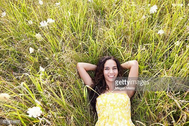 Woman in field of wildflowers
