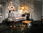 woman in flooded living room