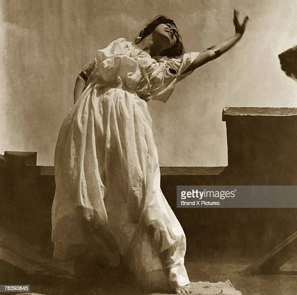 Woman in flowing dress dancing