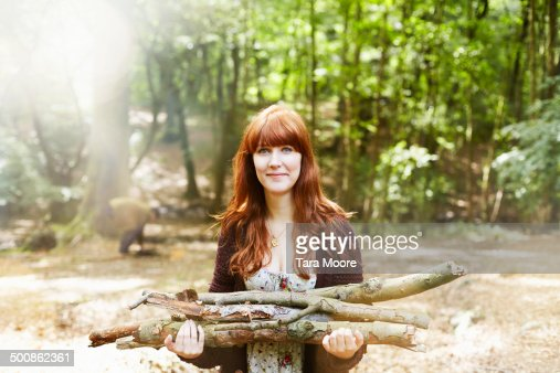 woman in forest collecting firewood