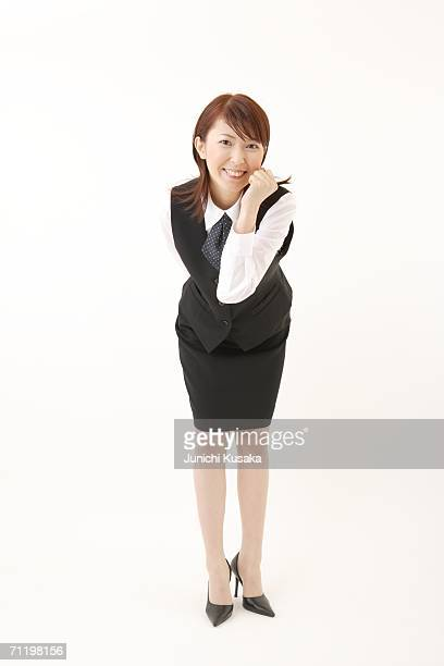 A  woman in formal attire expressing her motivation