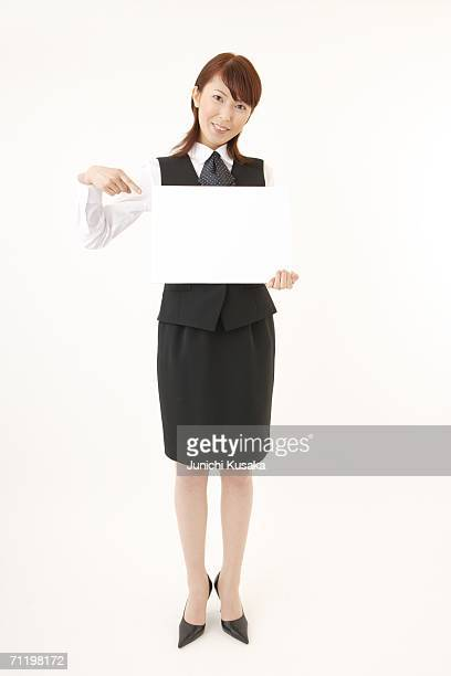 A  woman in formal attire holding a blank message
