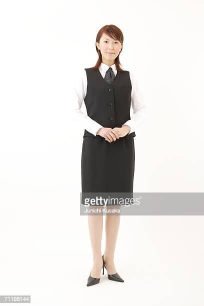 A  woman in formal attire posing
