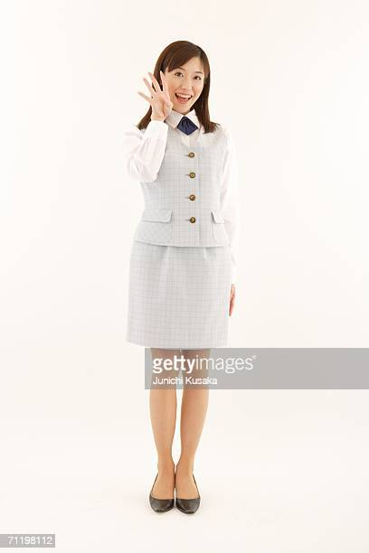 A  woman in formal attire smiling