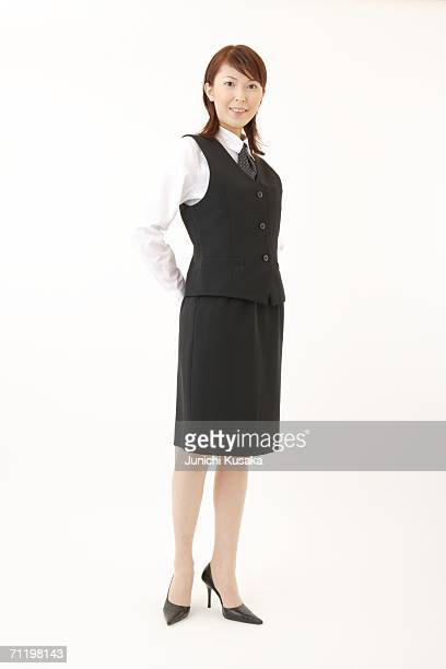 A  woman in formal attire standing