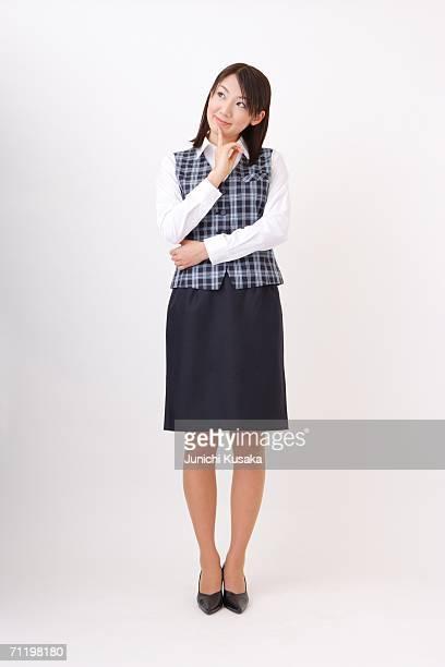 A  woman in formal attire wondering