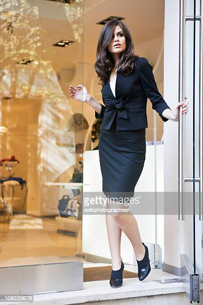 Woman in front of clothing store