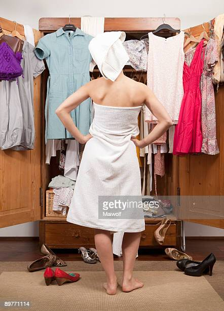 Woman in front of her closet, back view