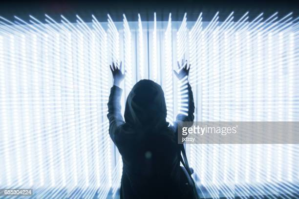 woman in front of LED lights dots array