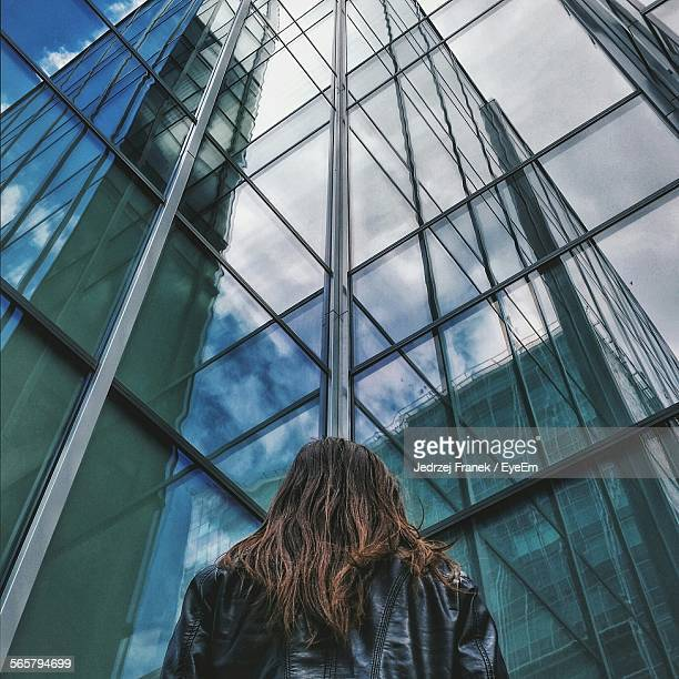 Woman In Front Of Office Building, Low Angle View