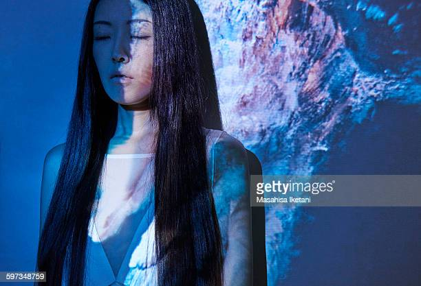 Woman in front of projection with Underwater model