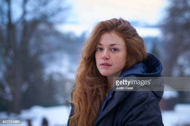 woman in front of snow covered landscape