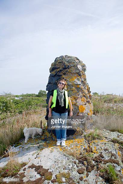 Woman in front of stone structure