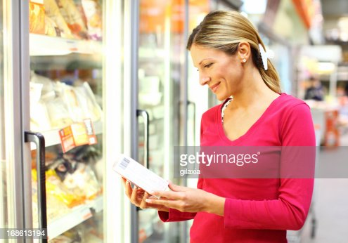 Woman in frozen-food section of supermarket