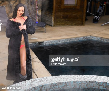 Woman in fur coat and bikini standing beside swimming pool - Warmepumpe fur pool ...