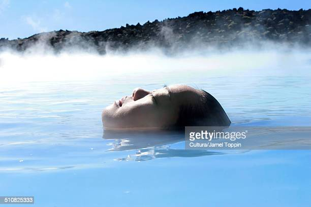 Woman in geothermal pool, Iceland