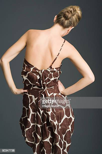Woman in giraffe print dress