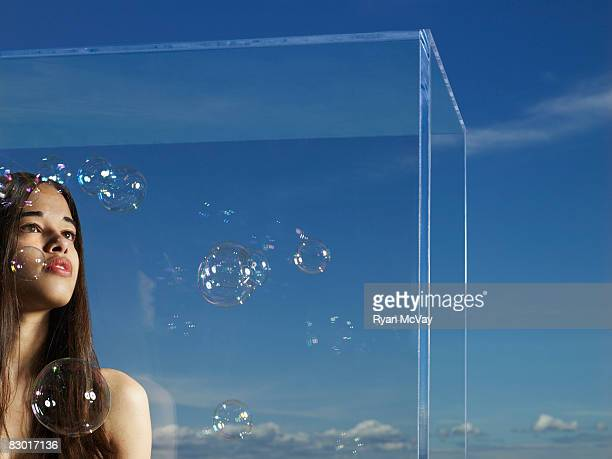 woman in glass box with bubbles