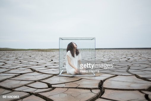 Woman in glass cube : Stock Photo