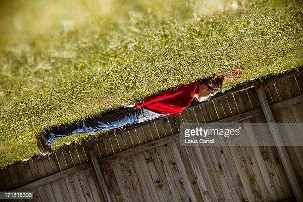 Woman in grass turned upside down