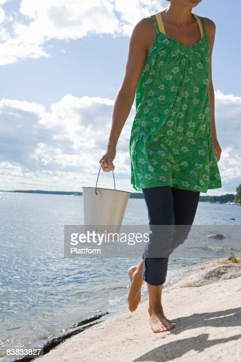Woman in green dress by the sea Sweden. : Stock Photo