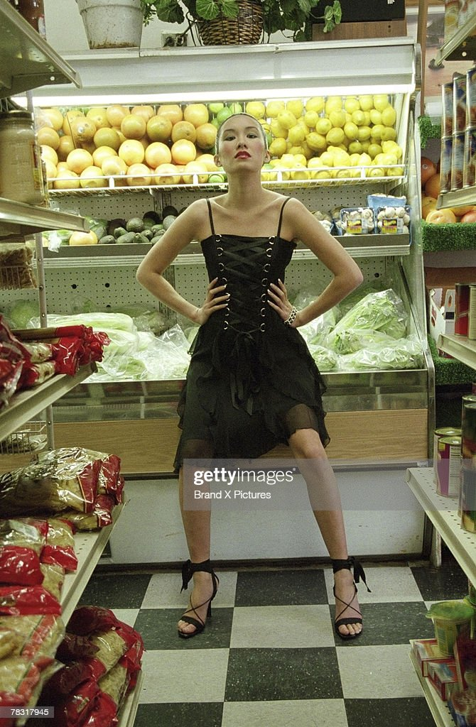 Woman in grocery aisle : Stock Photo