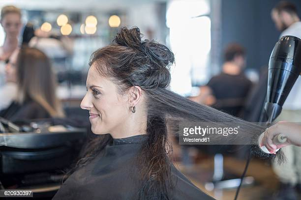 Woman in hair salon getting hair dried