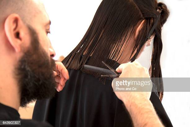 woman in hair salon, new haircut, with hairdresser