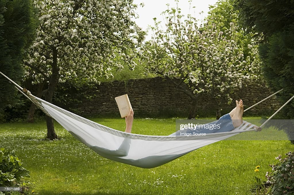 Woman in hammock reading book