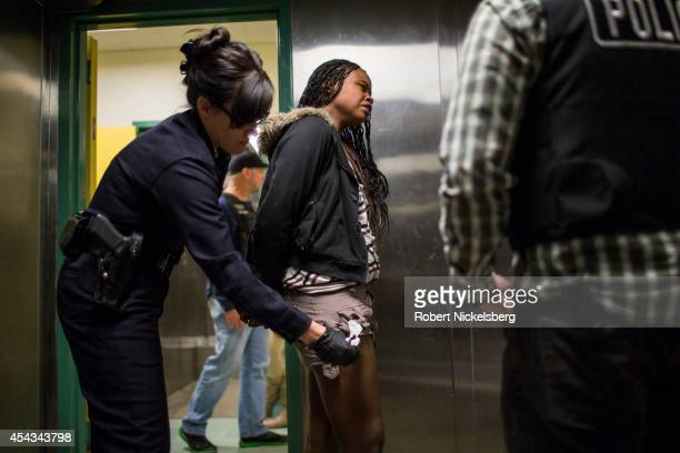 A woman in handcuffs breaks down while being searched in a holding room February 2 2013 by Los Angeles Police Department's vice squad officers at the...