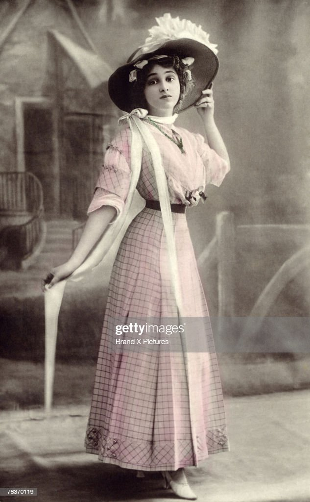 Woman in hat and dress