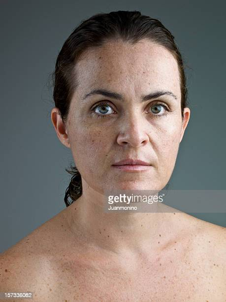 A woman in her 40s without make up in this headshot.