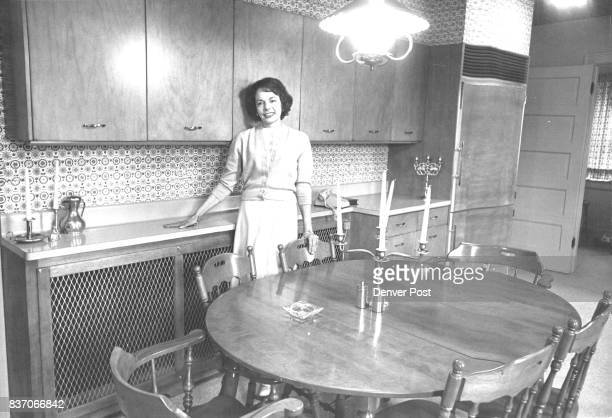 A woman In Her Castle Mrs James Voorhees Jr Poses in Her handsome kitchen one of the culinary centers featured on Wednesday's Kitchen Tour Sponsored...