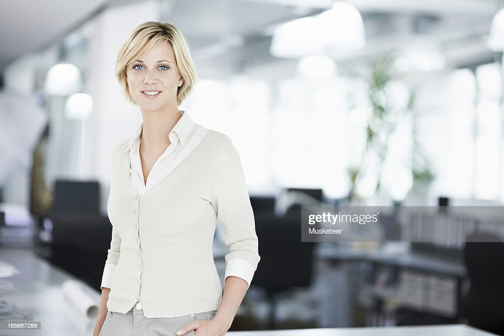 Woman in her office : Stock Photo