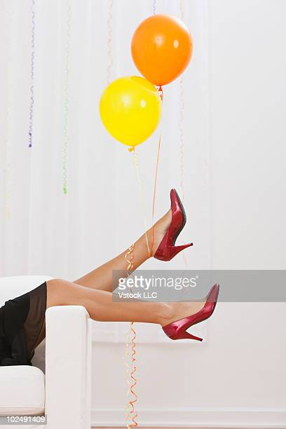 Woman in high heels at a party