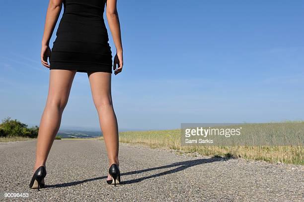 Woman in high heels on empty road
