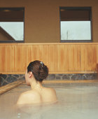 Woman in hot tub, rear view