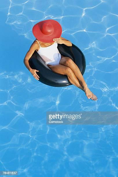 Woman in inner tube in pool