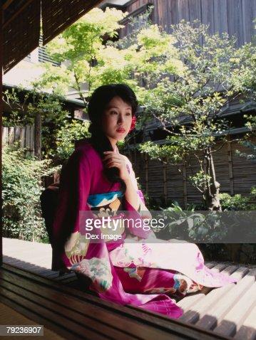 Woman in Japanese garden, portrait : Stock Photo