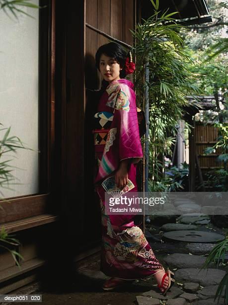 Woman in Japanese garden, portrait