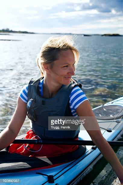 Woman in kayak, looking away